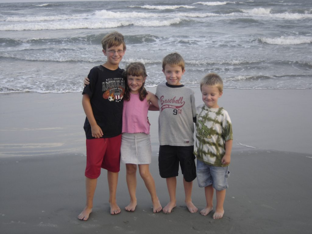 The Little Willis Kids Standing on the Beach