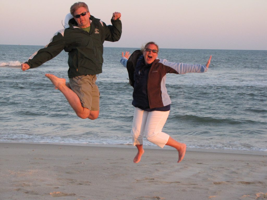 Chris and Katrina Jumping on the Beach