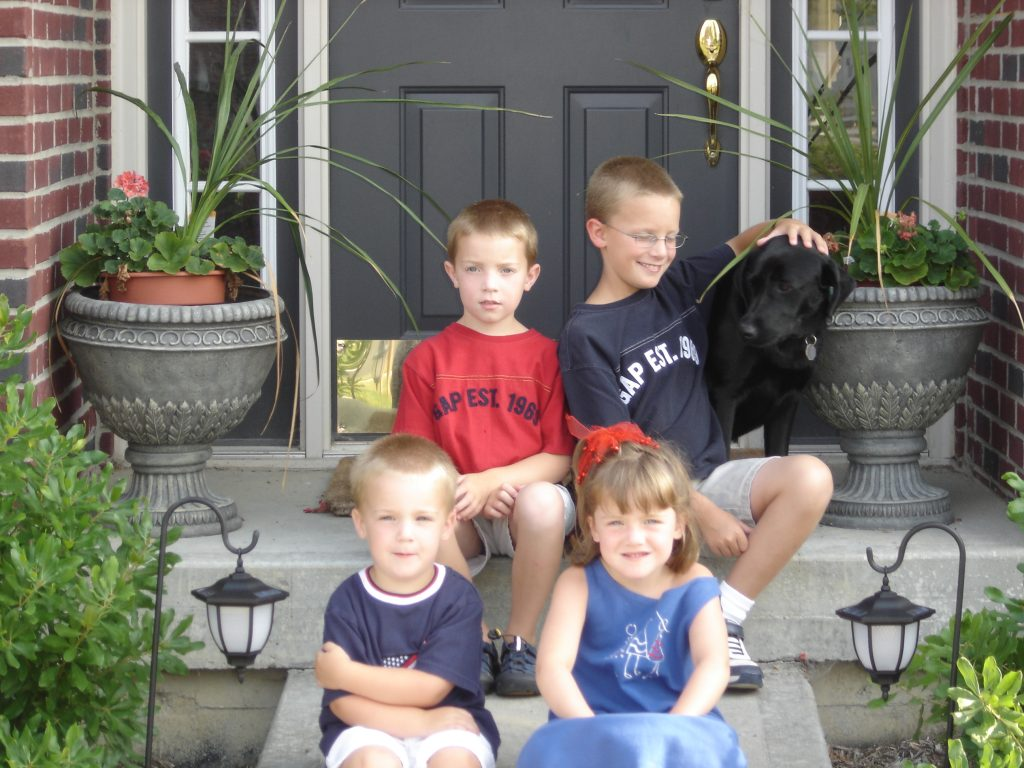 The Kids and Maggie Sitting on the Front Steps
