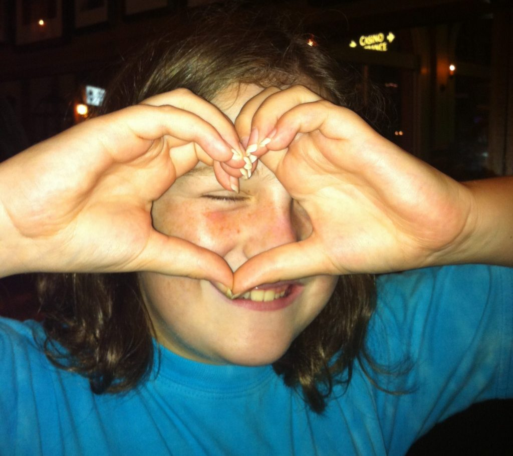 Mary Clair Making a Heart with Her Hands