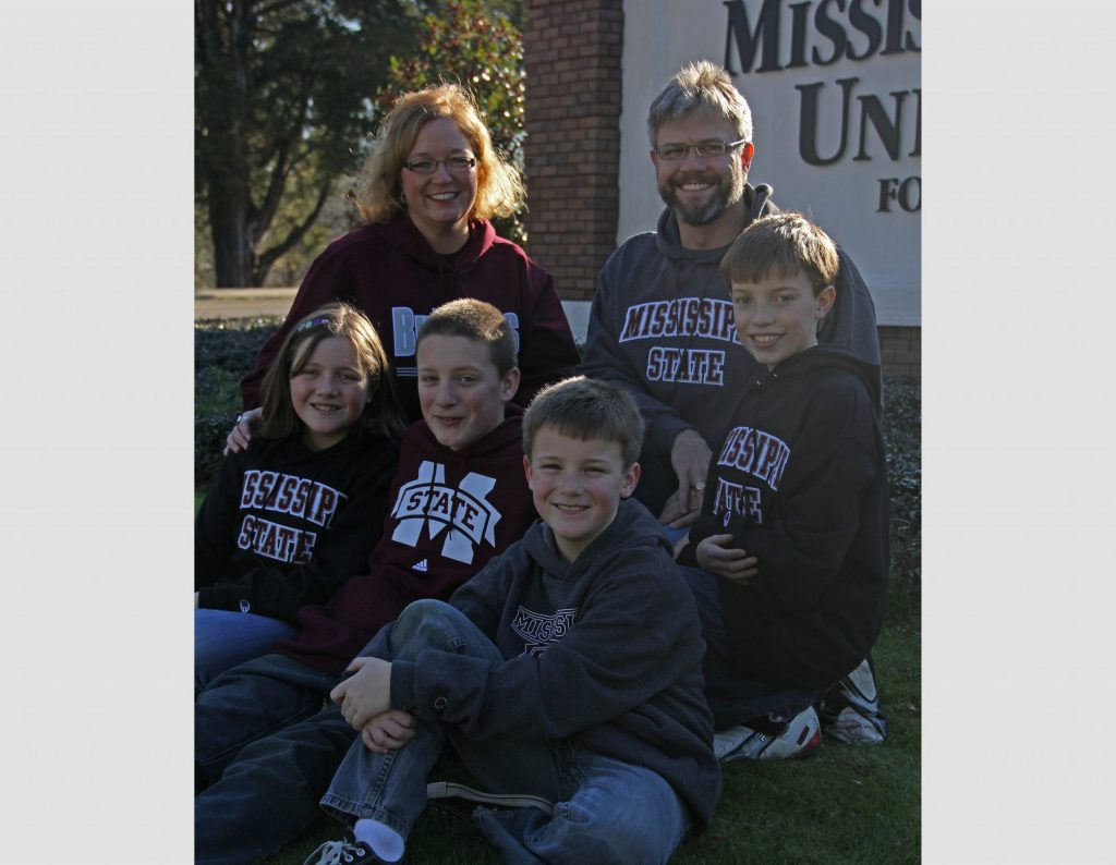 The Family Posed in Front of the MSU Sign