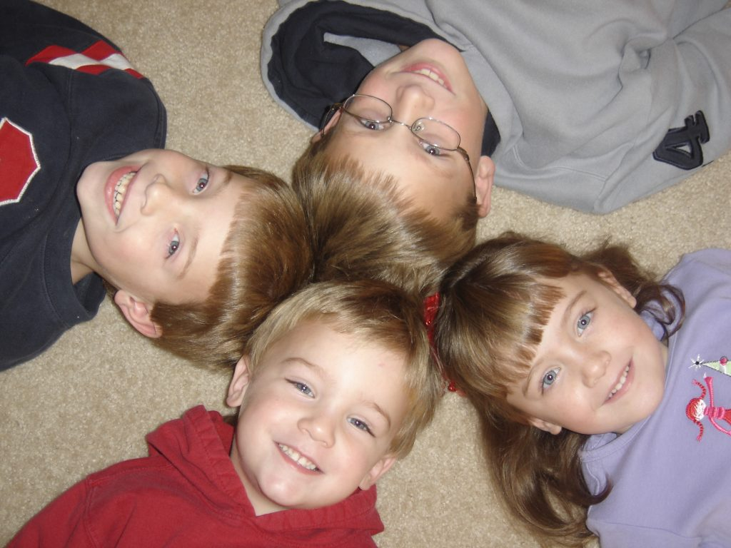 Kids Laying on the Floor with Their Heads Together