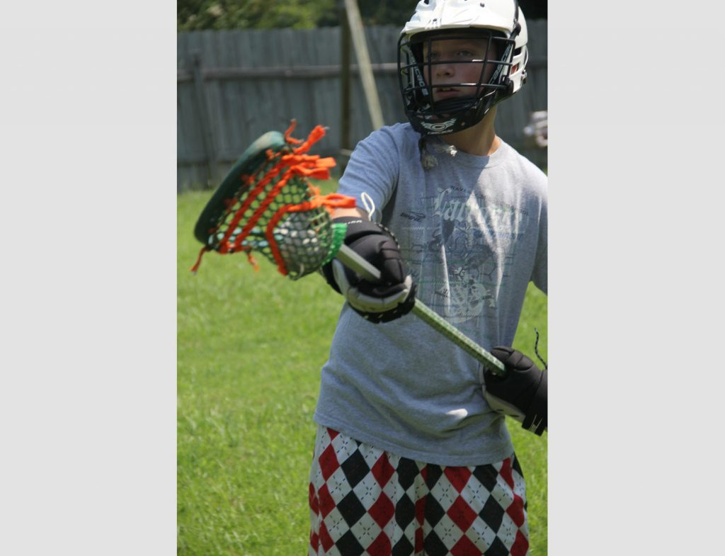 Sam Playing Lacrosse