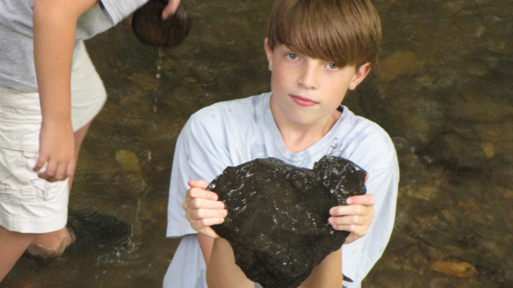 Gus Holding a Heart-Shaped Rock