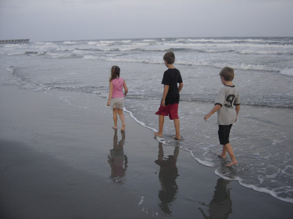 Kids Walking on the Beach