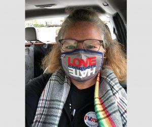 Katrina Willis with Love Conquers Hate Mask on Voting Day